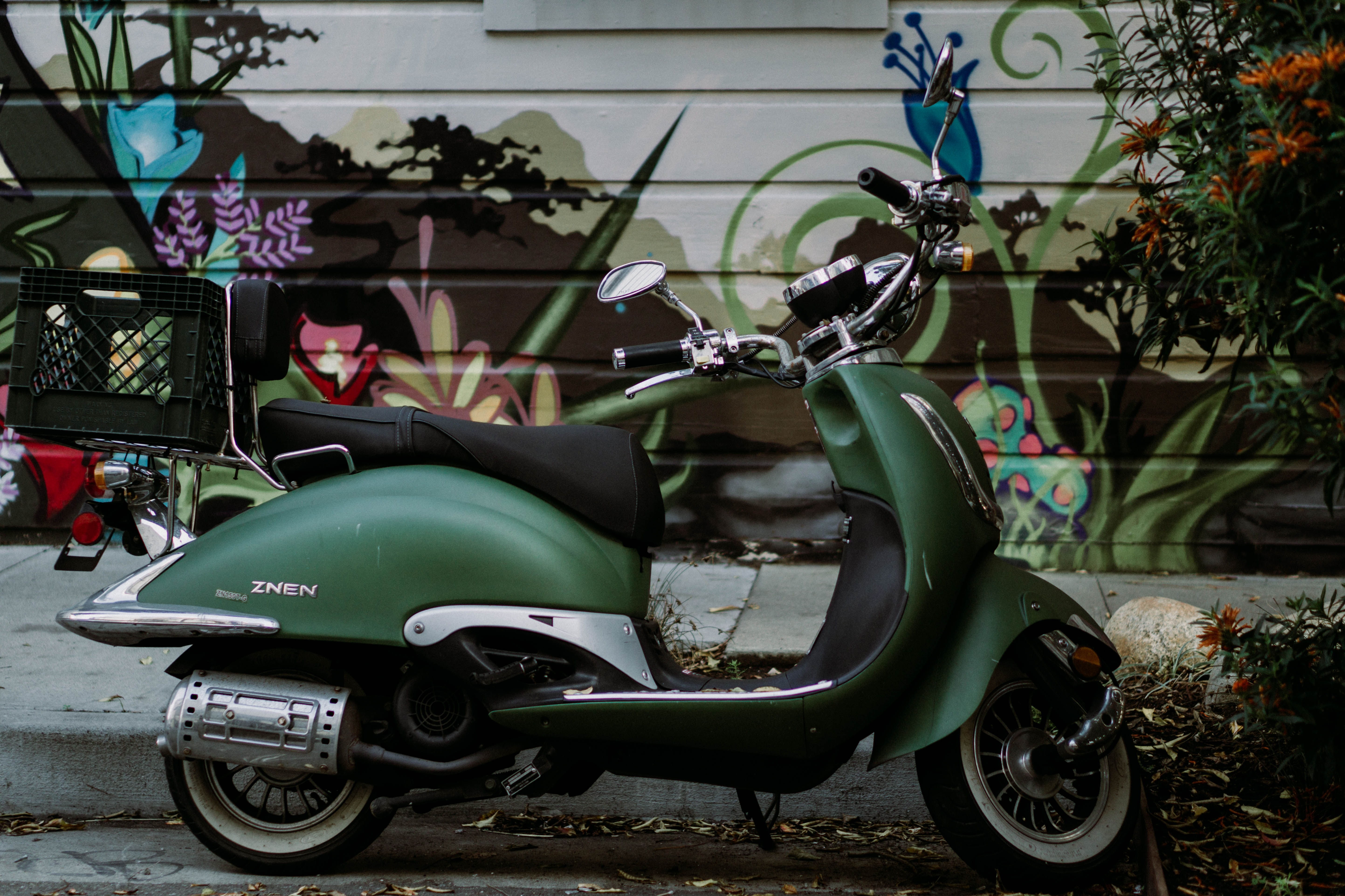 green and black motor scooter