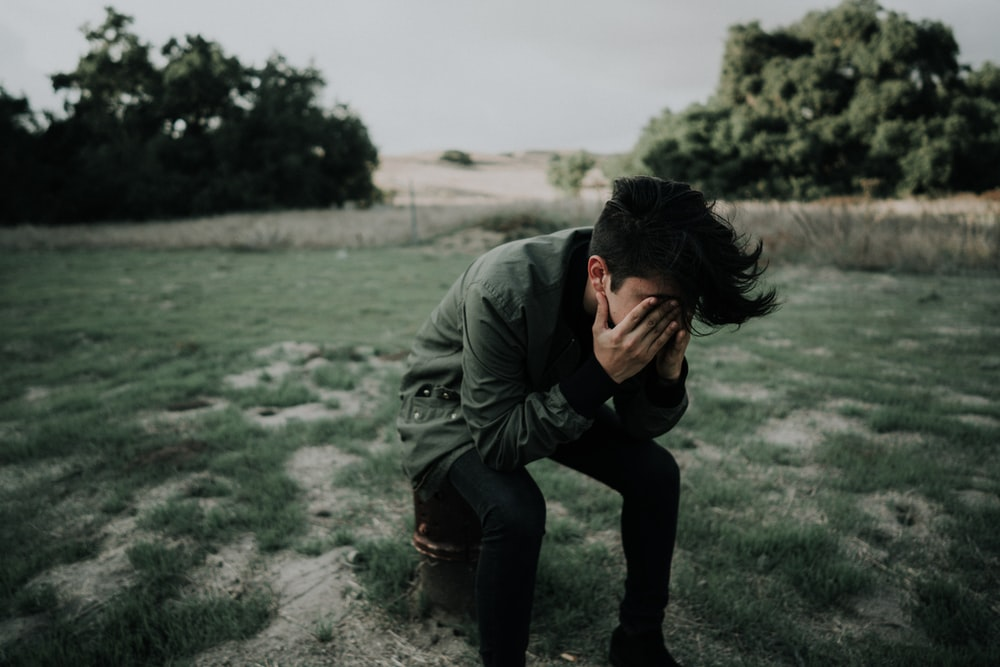 Sad vibe pictures download free images on unsplash man wearing green jacket sitting on stool chair altavistaventures