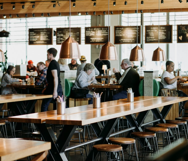 Reading newspaper in a café photo by rob bye robertbye