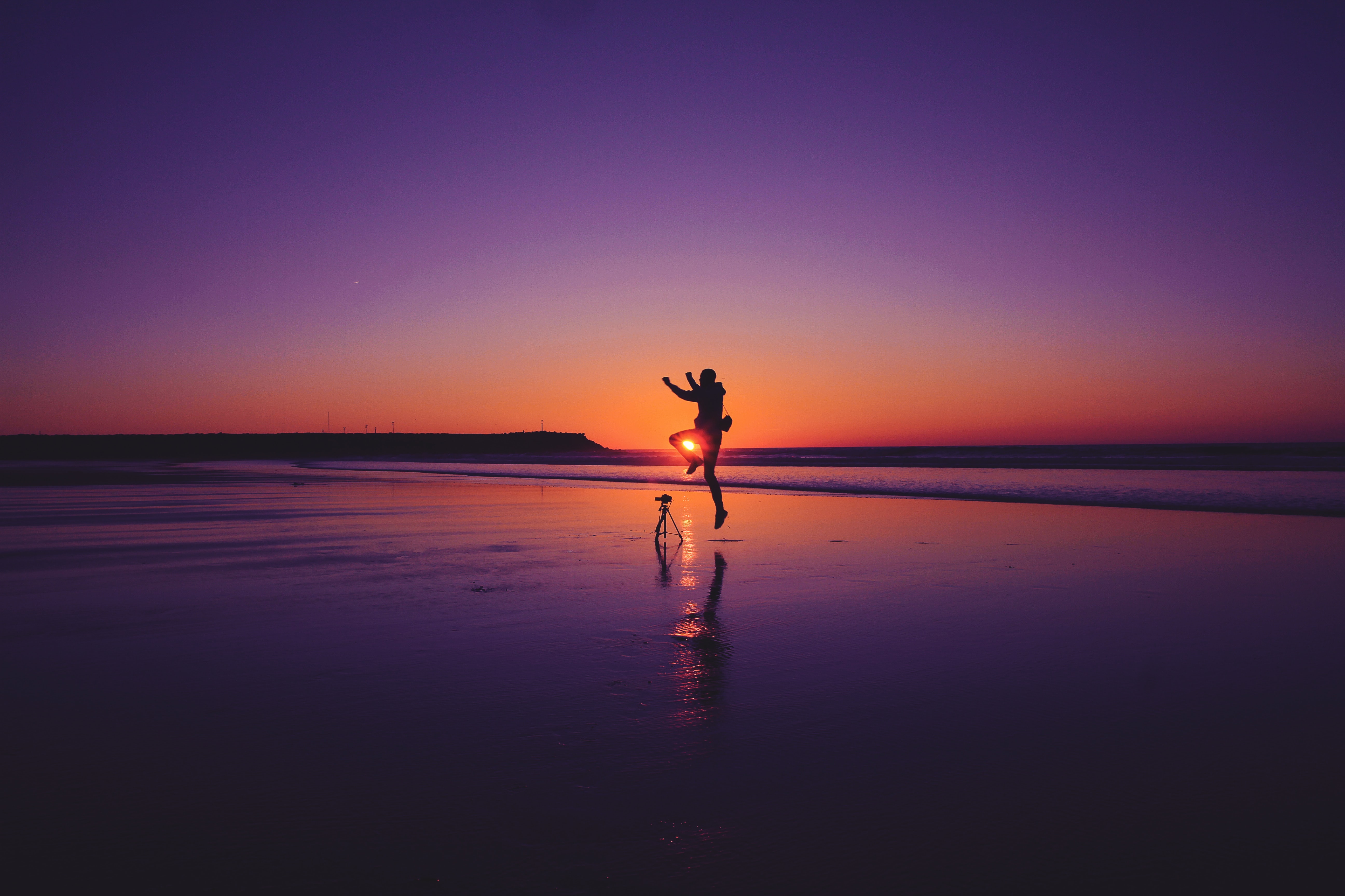 silhouette of man on beach