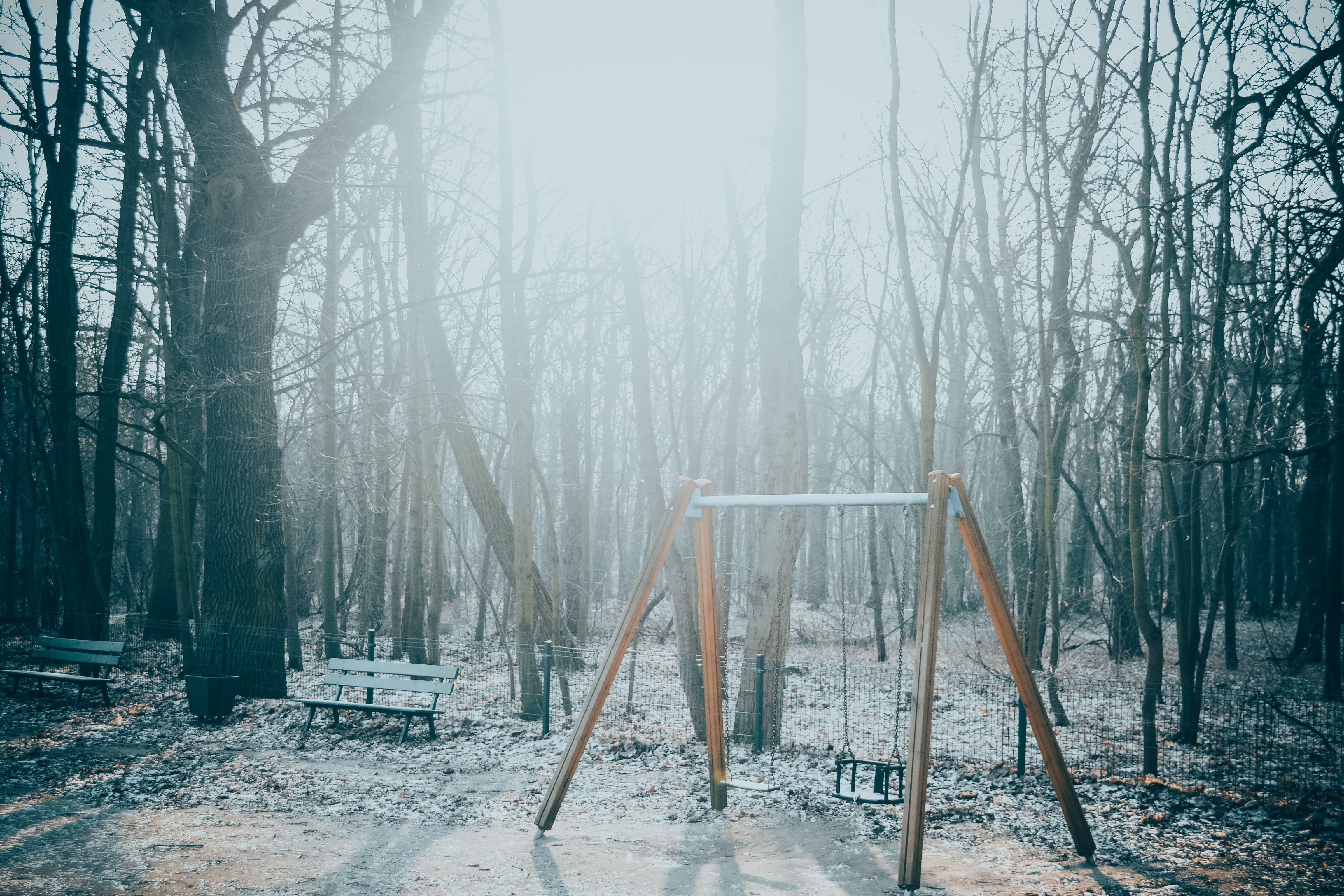 gray and brown metal swing outdoor