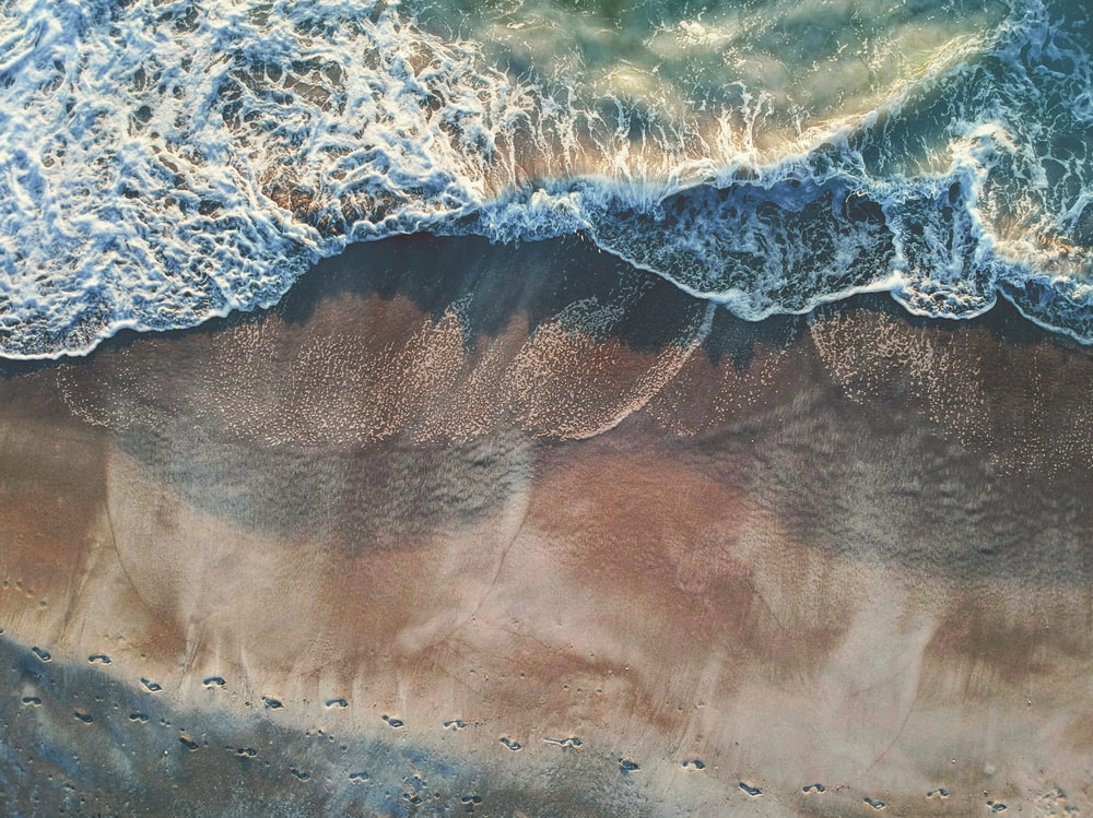 aerial photography of footprints on shore during daytime