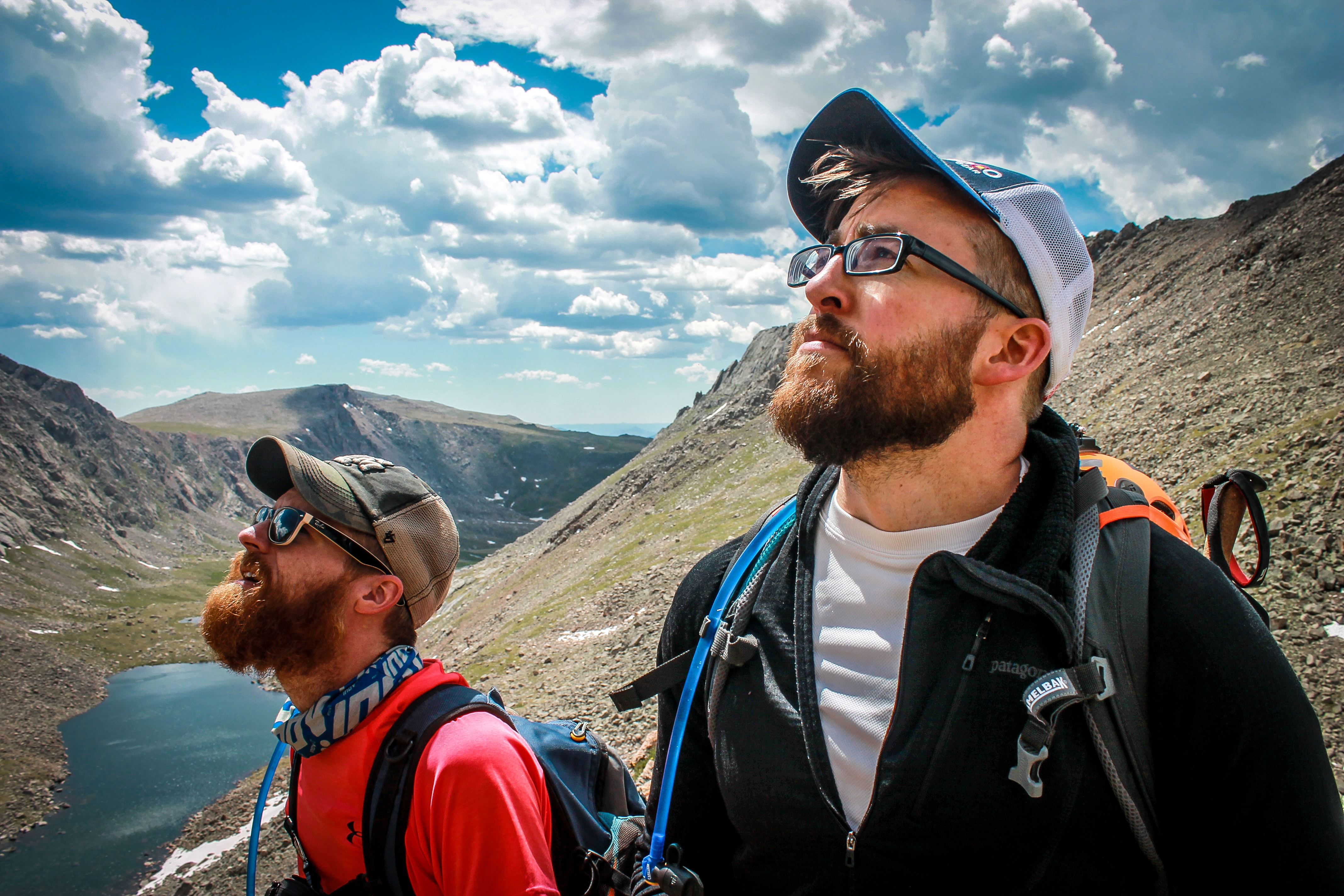 two male hikers looking up at the sky