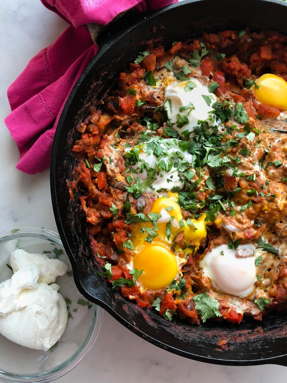 cooked meat with eggs in skillet