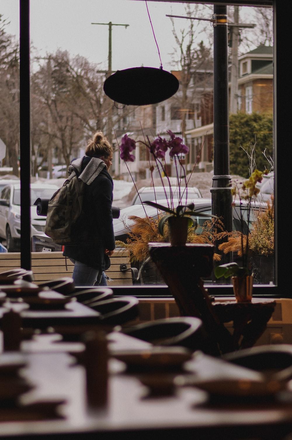 woman walks on sidewalk
