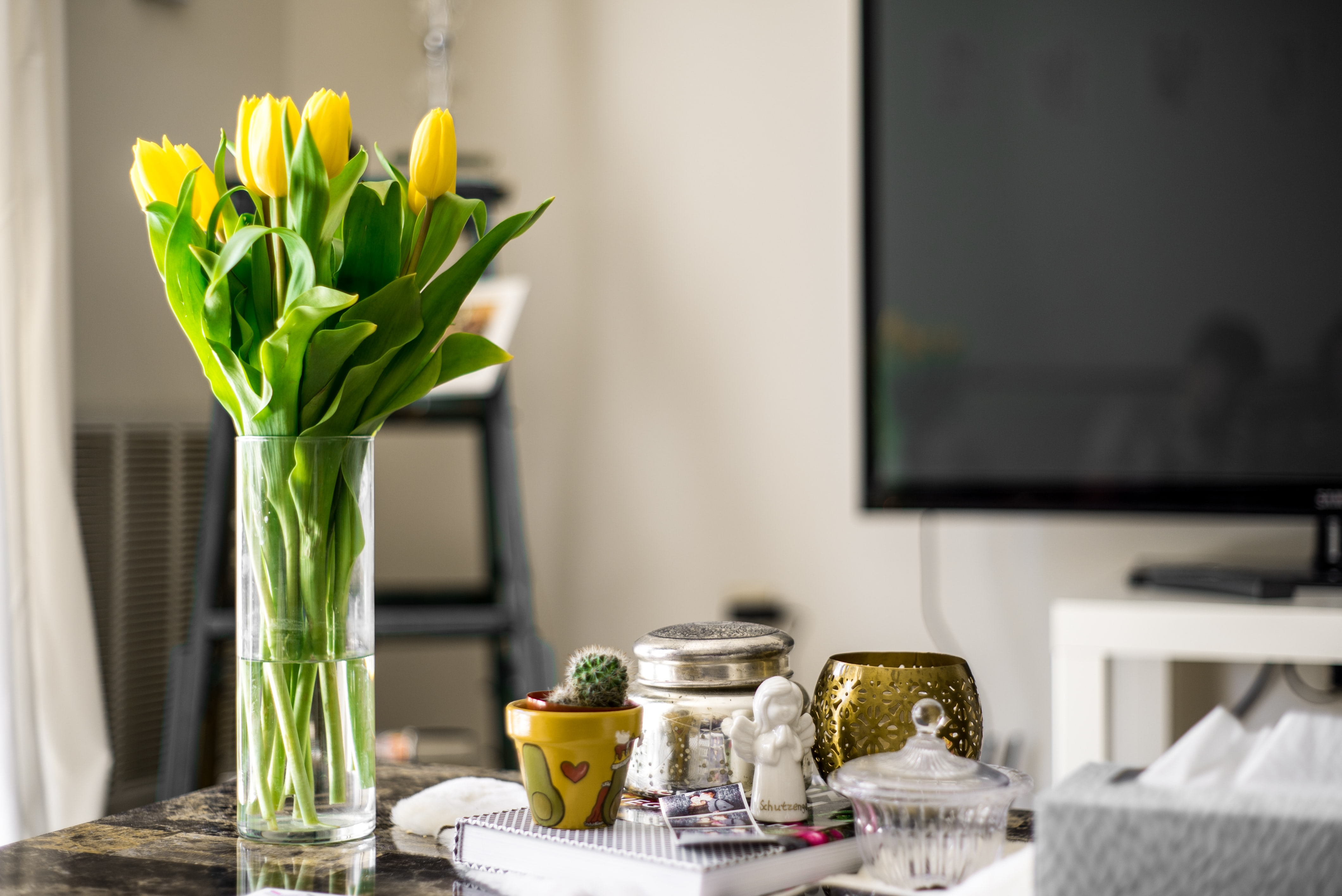 yellow tulip flowers inside vase on table