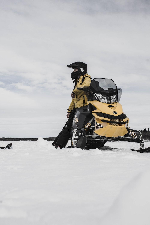 man riding on snowmobile