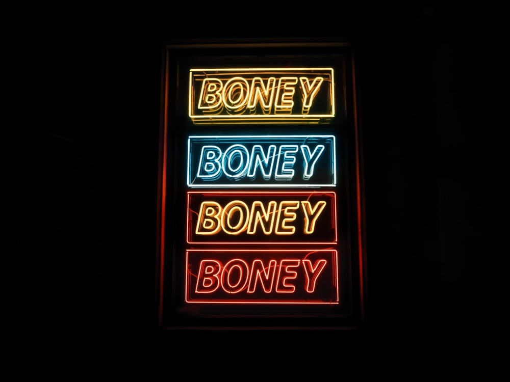 photo of yellow, blue, and red Boney neon sign