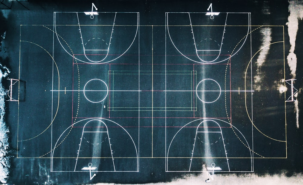 green and white basketball court in top view photography
