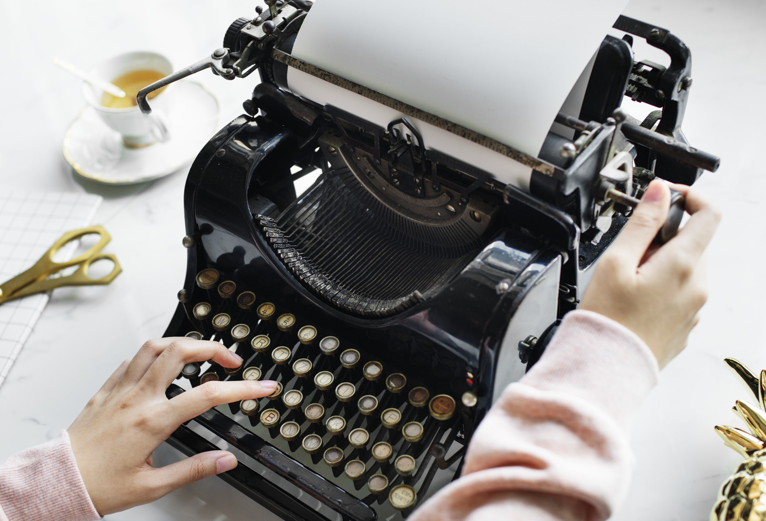 person using black typewriter
