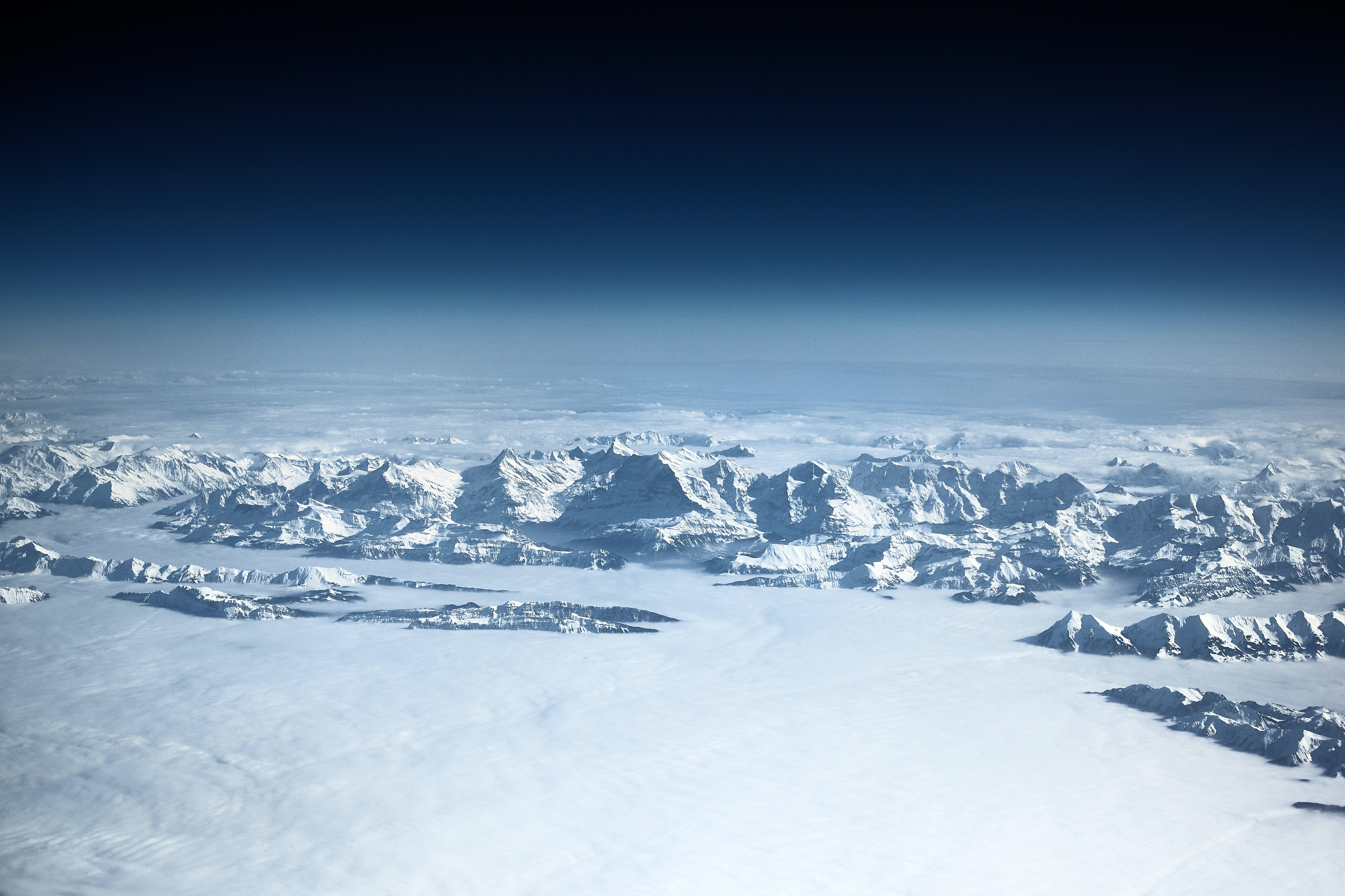 aerial view photography of white snow-covered mountain