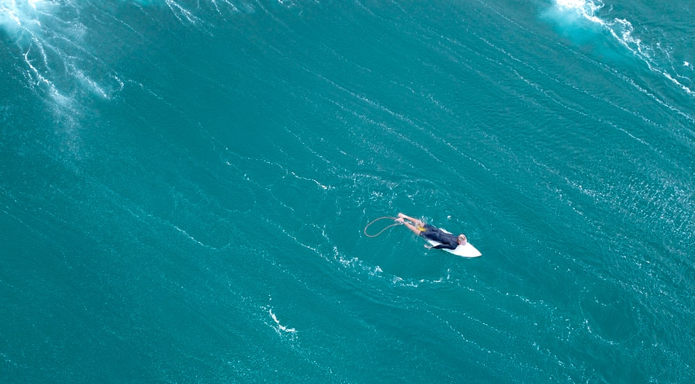 aerial photography of man surfing