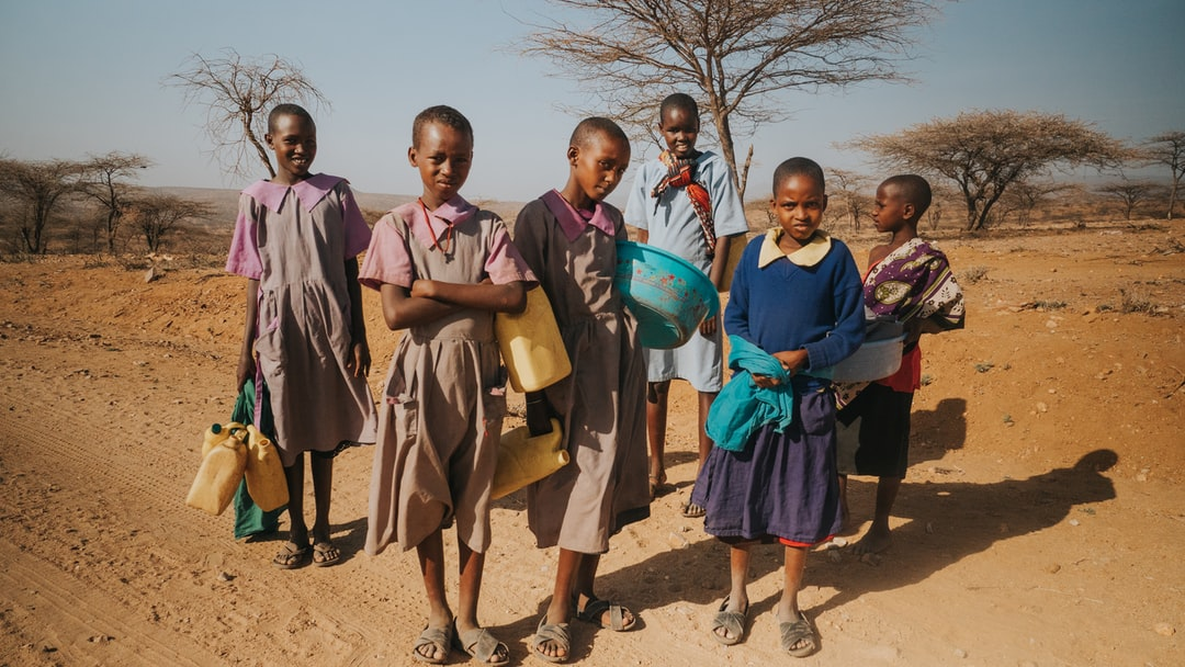 Found myself massively impacted by these people in a remote region of northern Kenya. Life is hard, water is a few kilometres away in a dried up river bed and these girls walk there and back a few times a day.