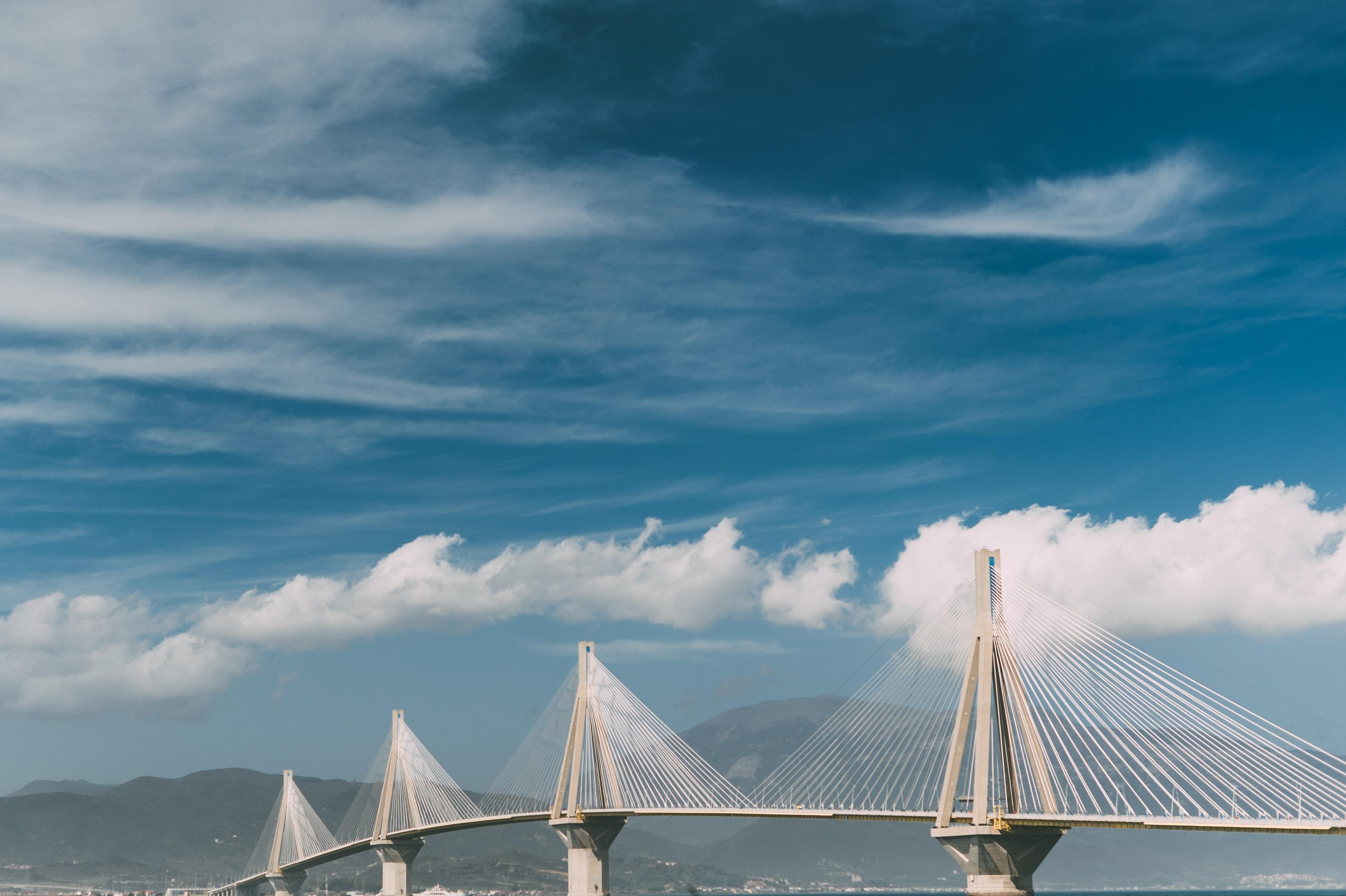 white cantilever bridge under blue sky