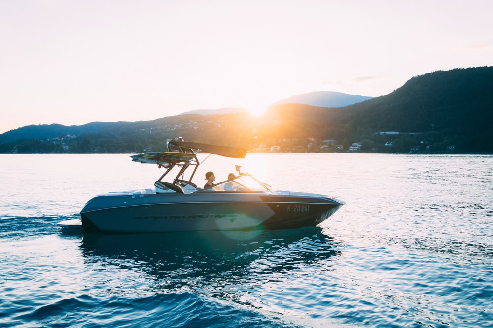 photo of people riding power boat