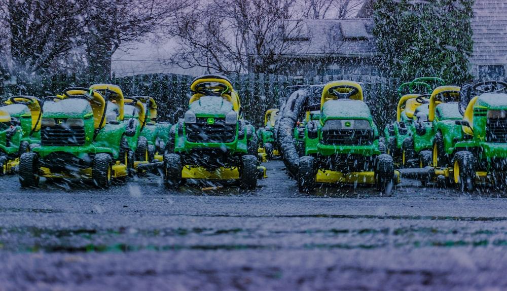John Deer ride-on mower lot under the rain