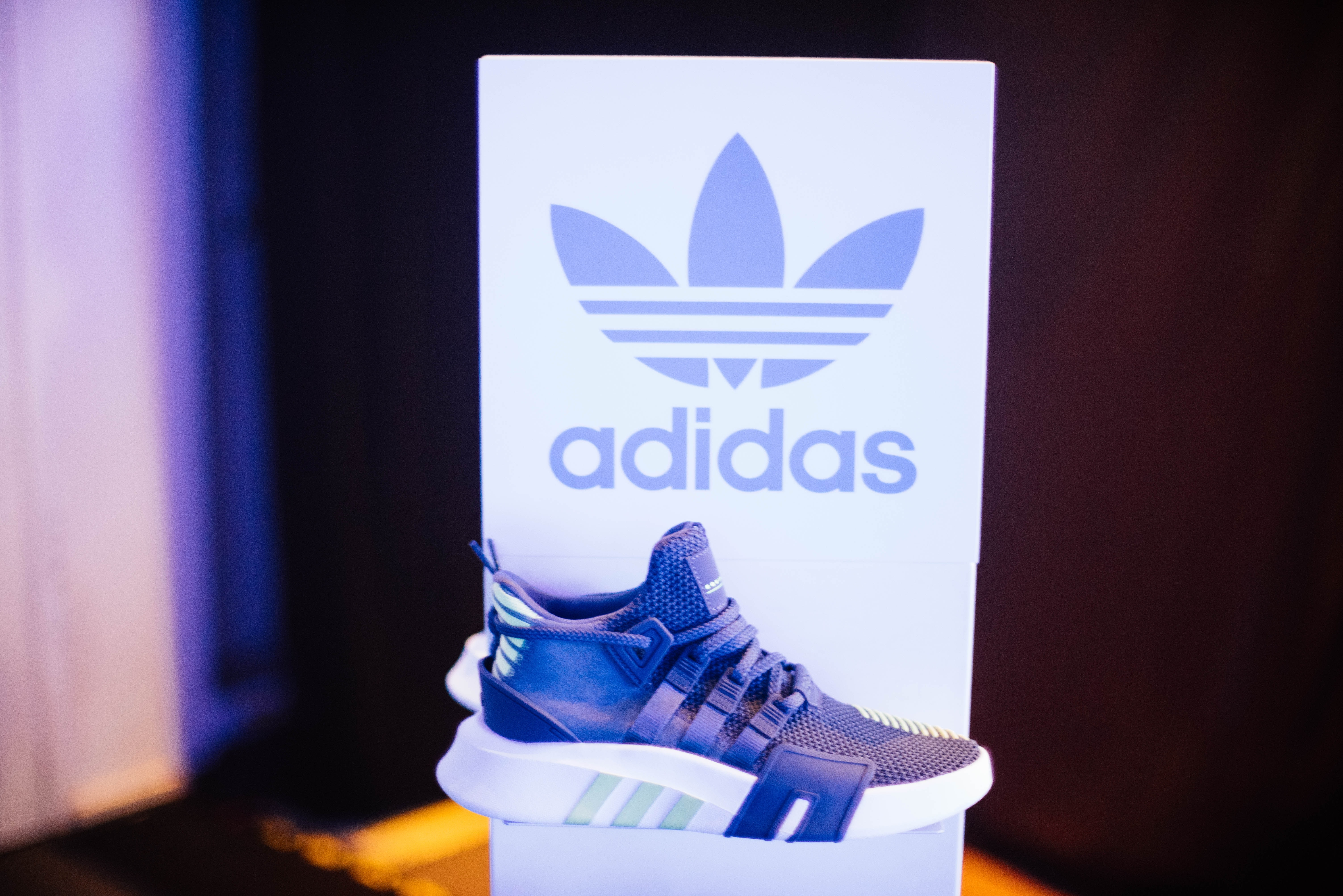 unpaired blue and white adidas running shoe