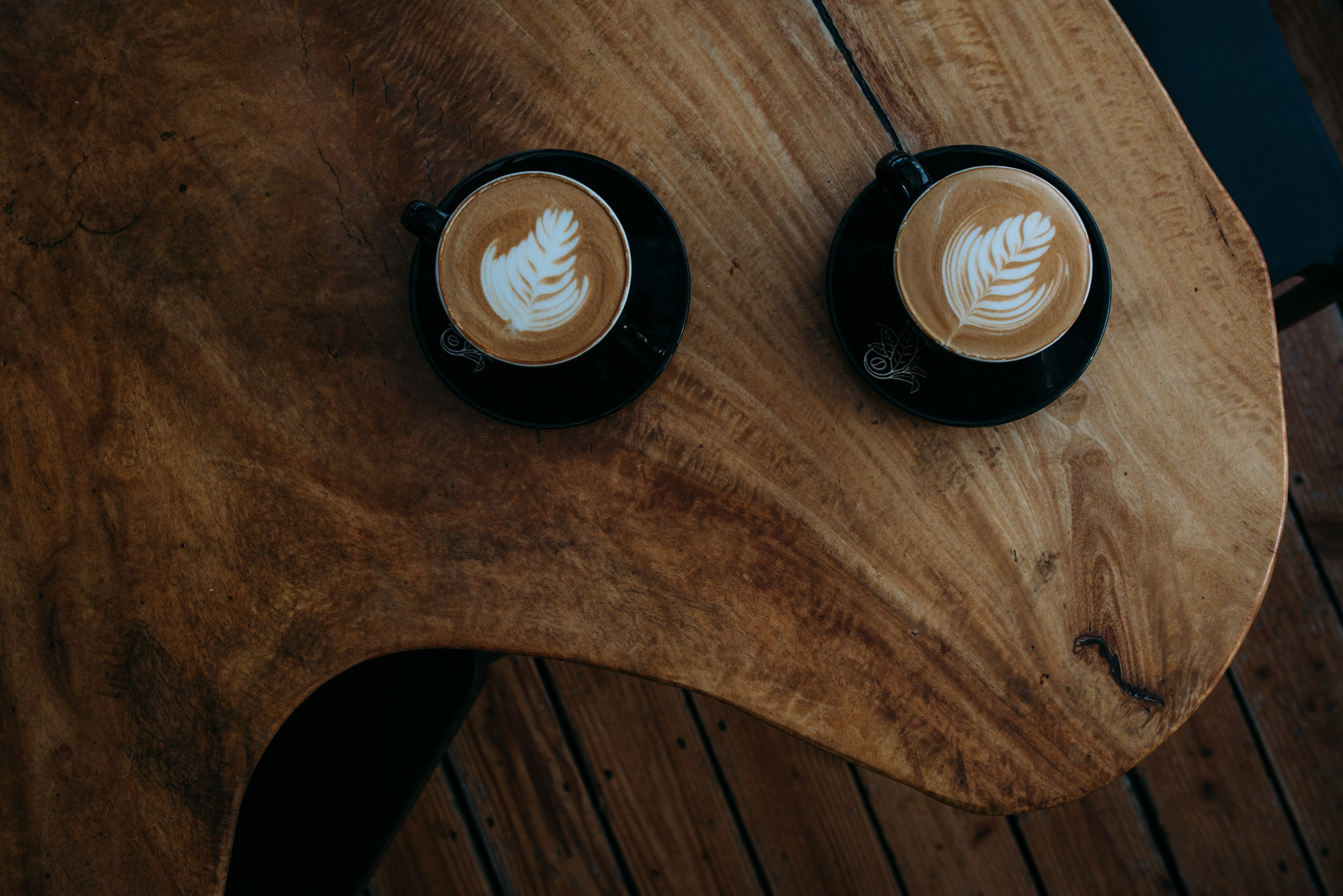 two coffee arts on brown wooden table