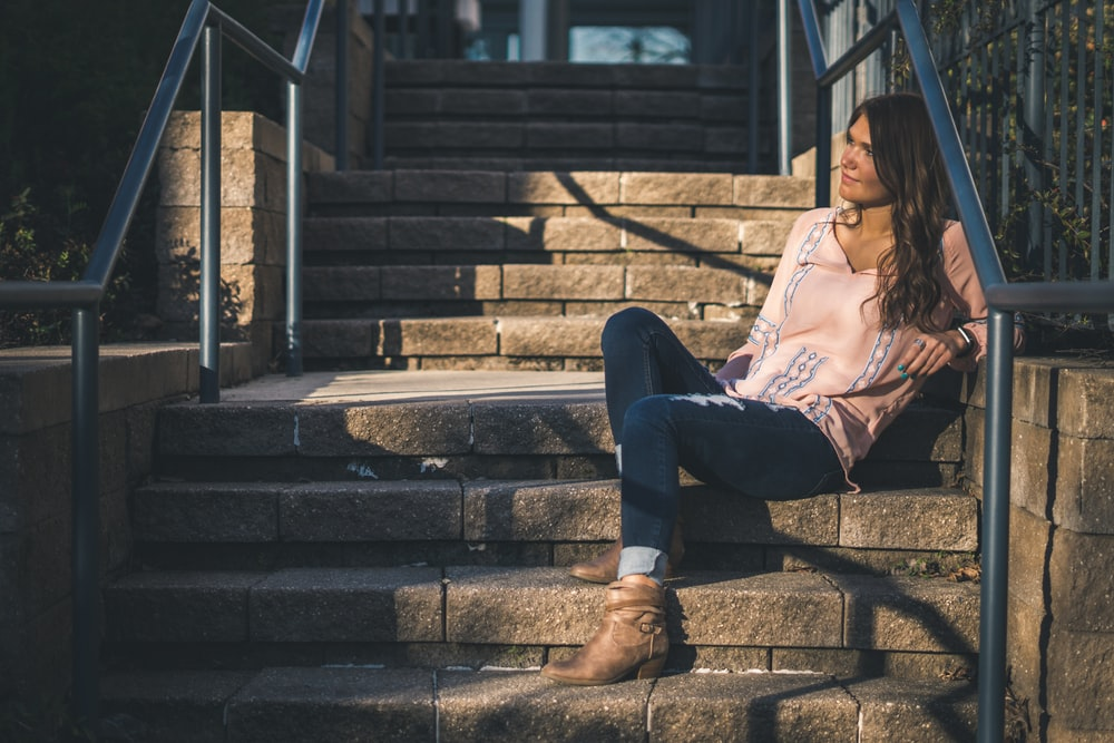 woman sitting on stairs outdoor