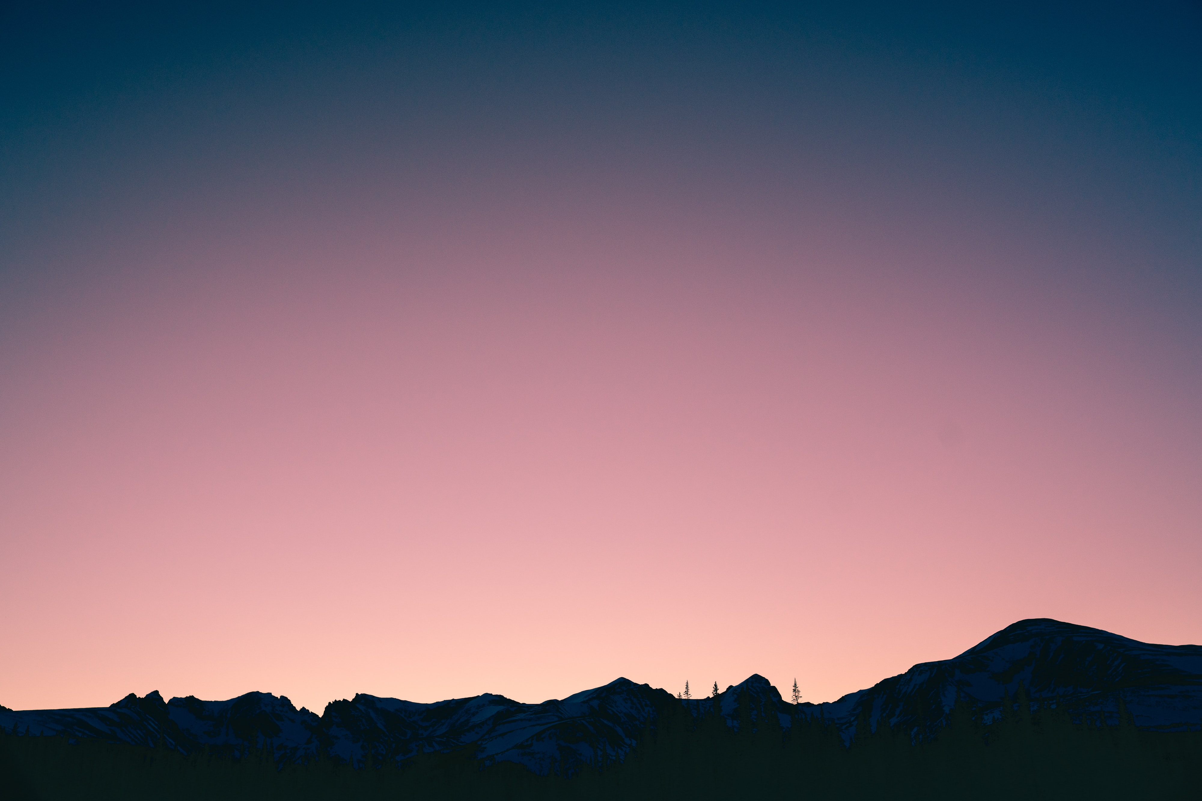 silhouette of mountain with pink sky