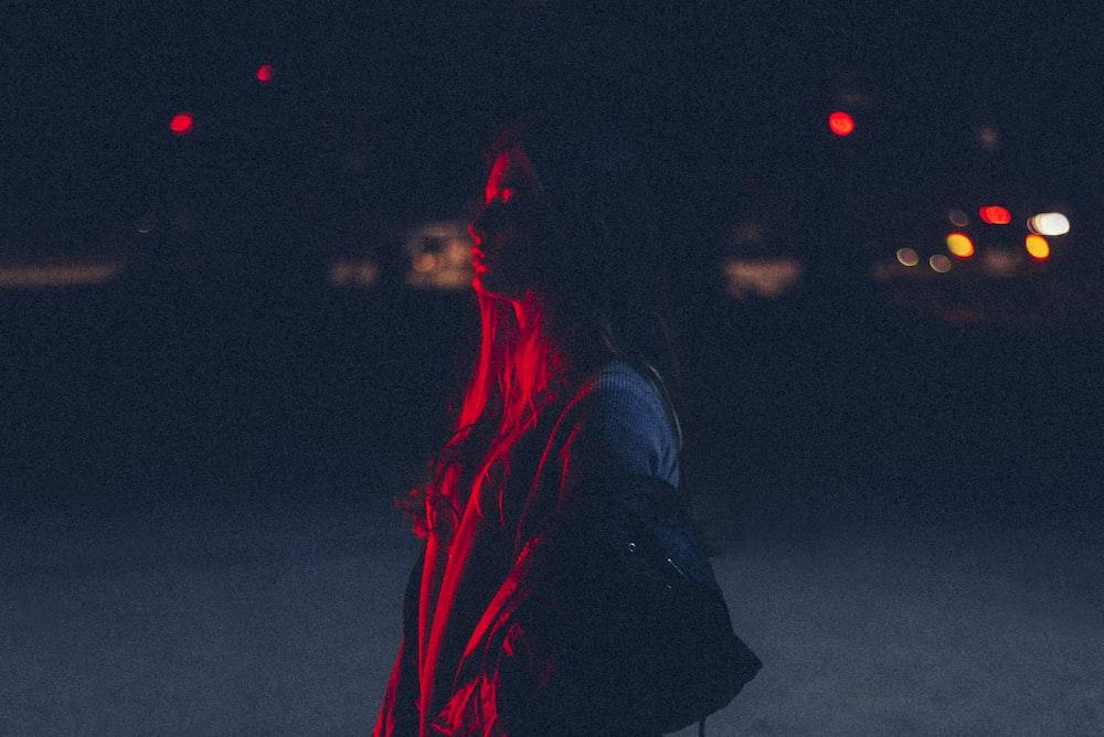 woman carrying bag during nighttime