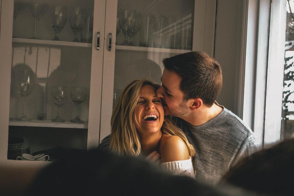 Man Kissing Her Girl On Forhead