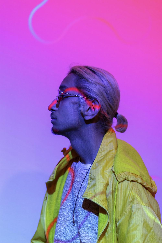 man wearing yellow jacket