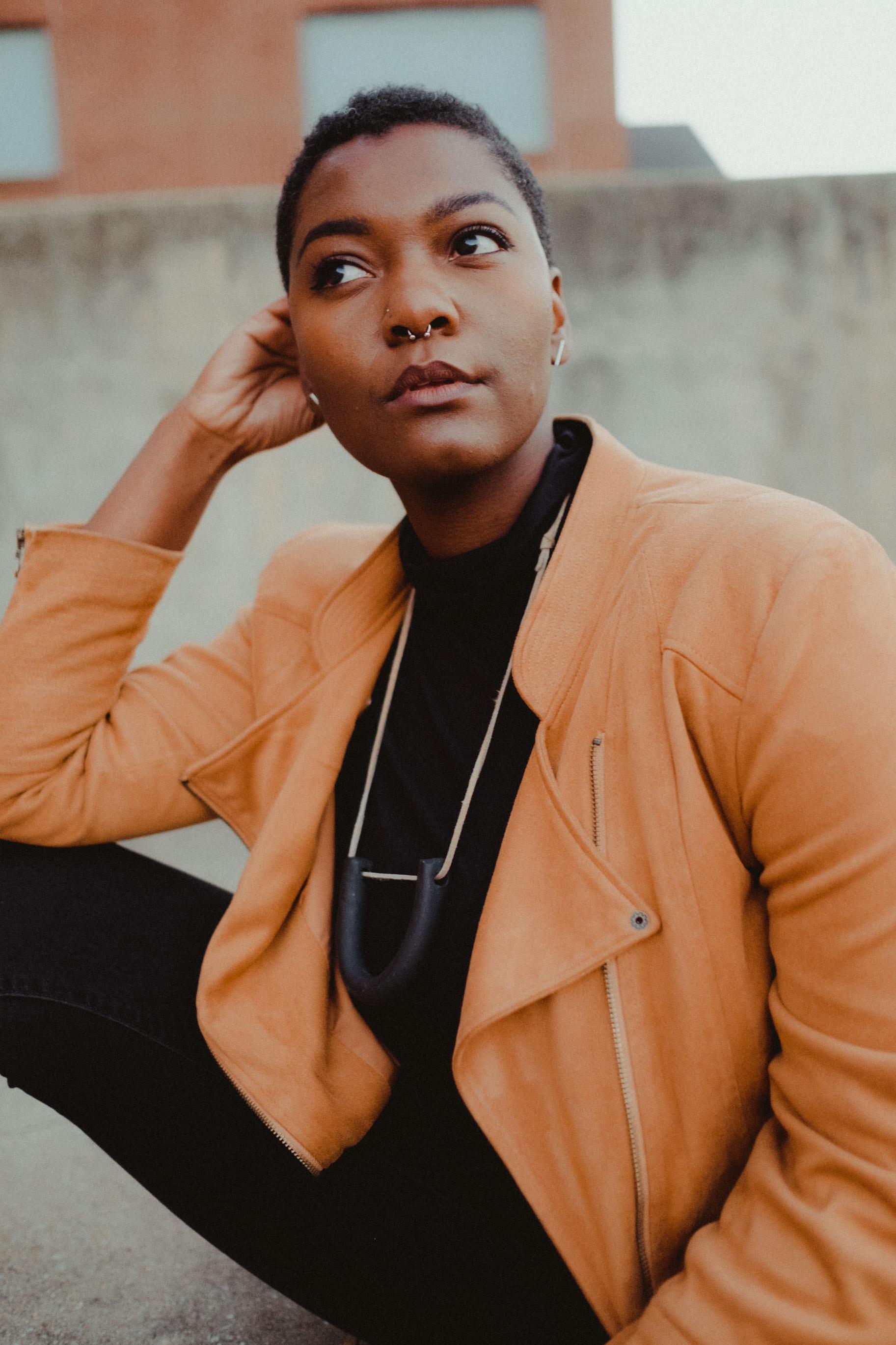 woman wearing brown jacket sitting