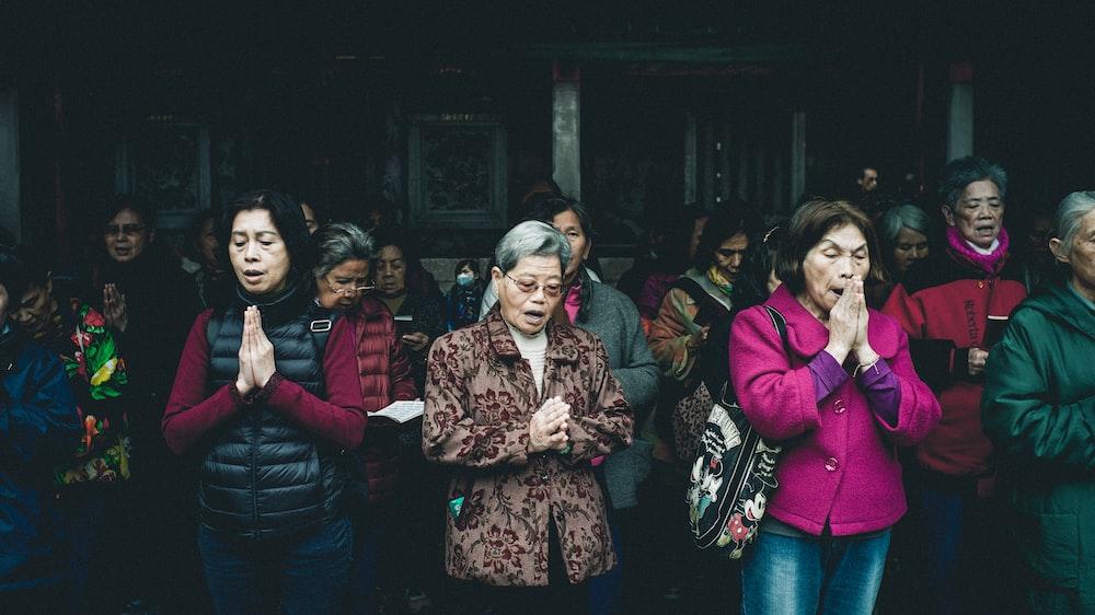 women's praying while standing