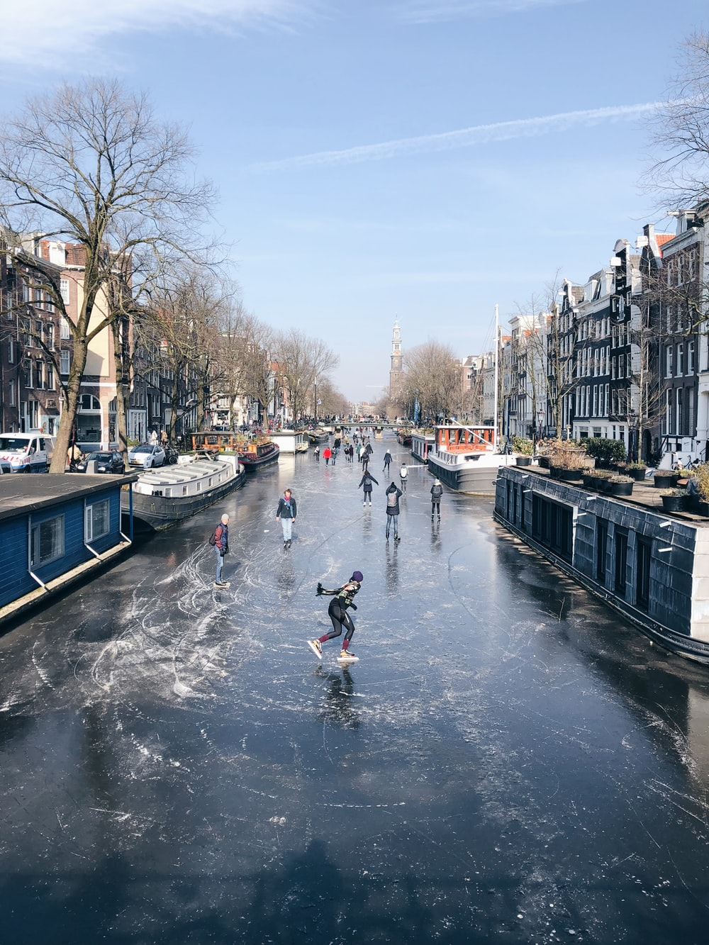person ice skating during daytime