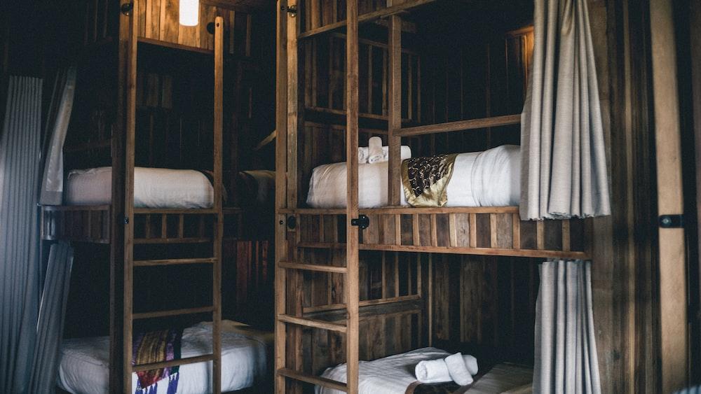 brown wooden bunk beds