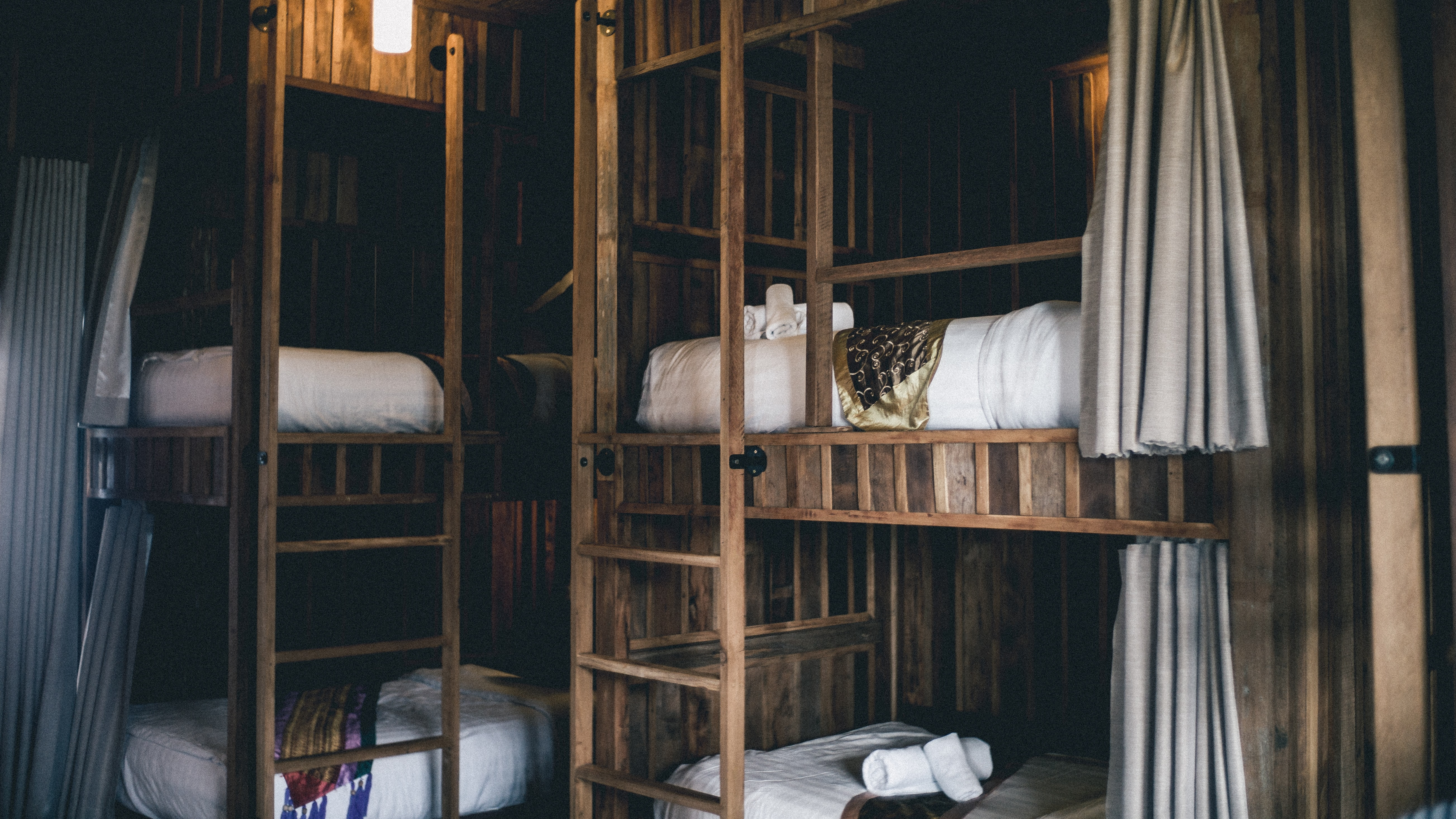 brown wooden bunk beds