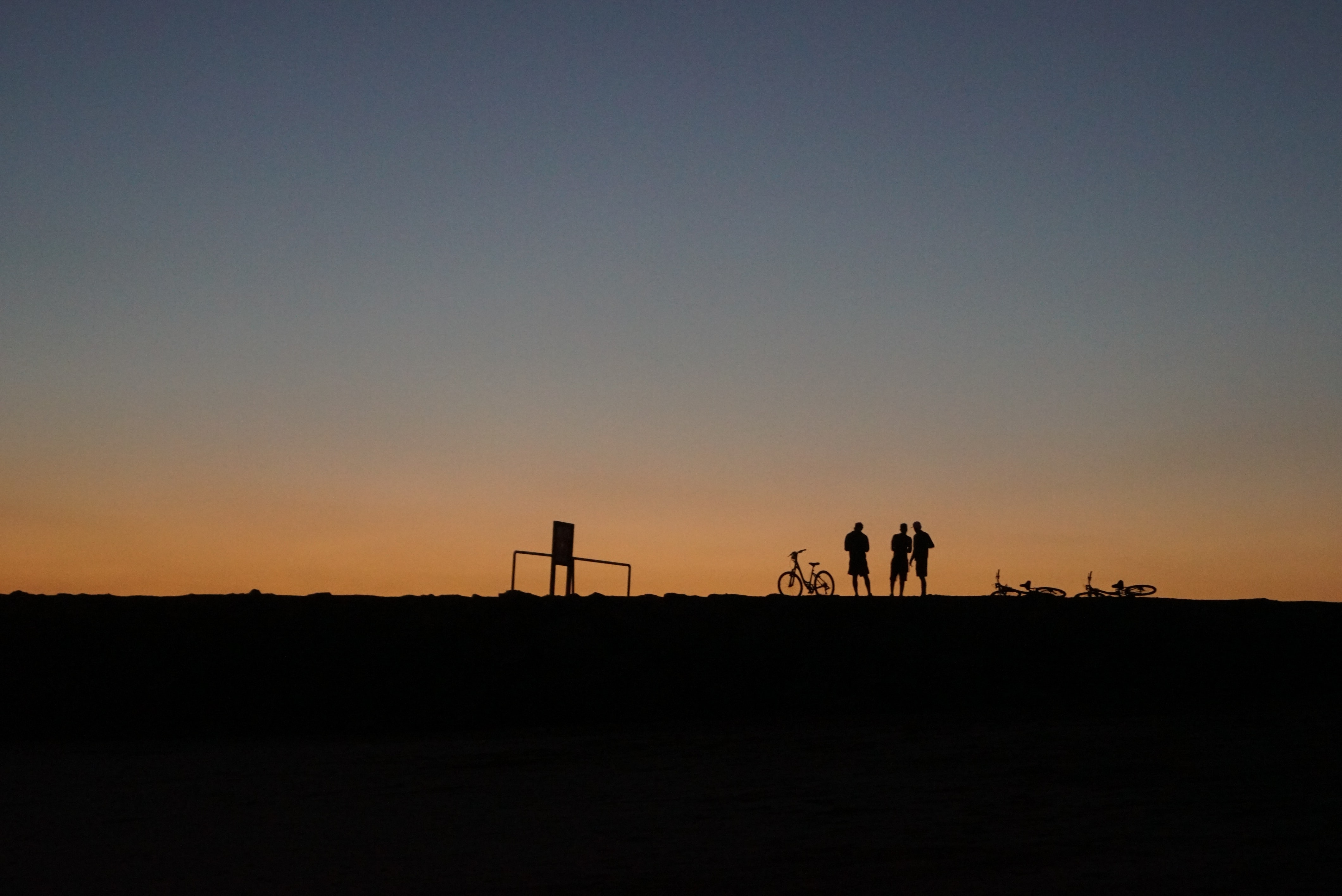 silhouette photography of three people