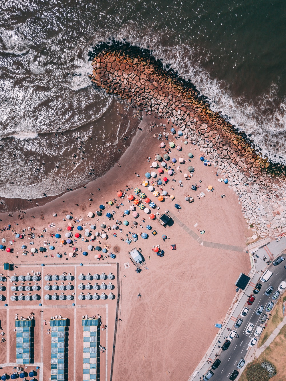 aerial photography of people near ocean