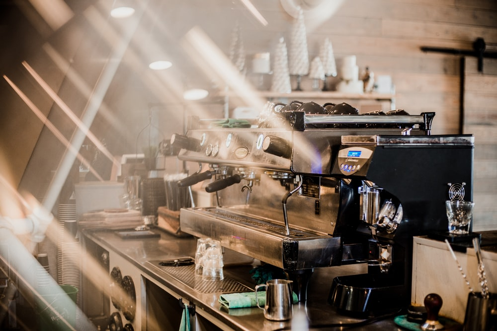 silver and black espresso maker on cafe