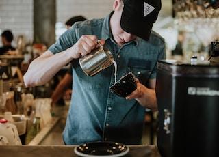 man making a coffee latte