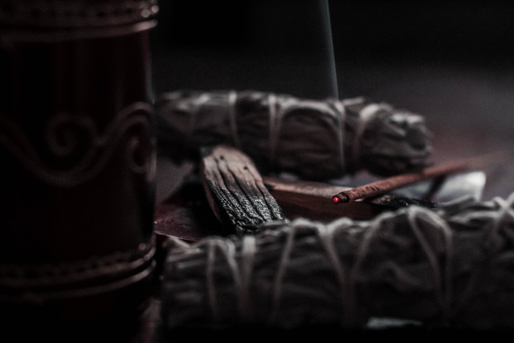 shallow focus photography of lighted incense