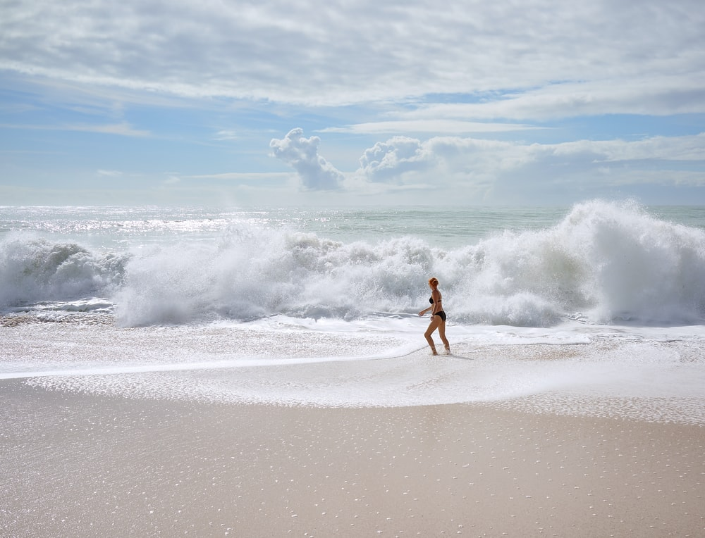 woman facing ocean waves