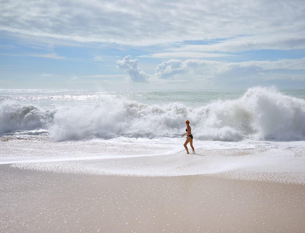 woman facing ocean waves