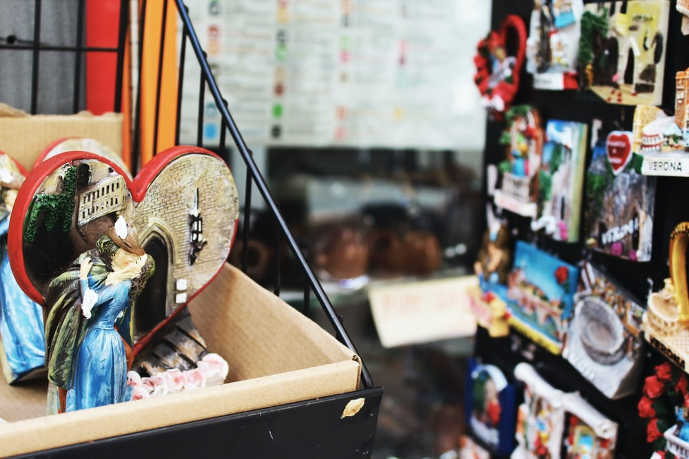 couple kissing figurine on top of rack near display of product packs
