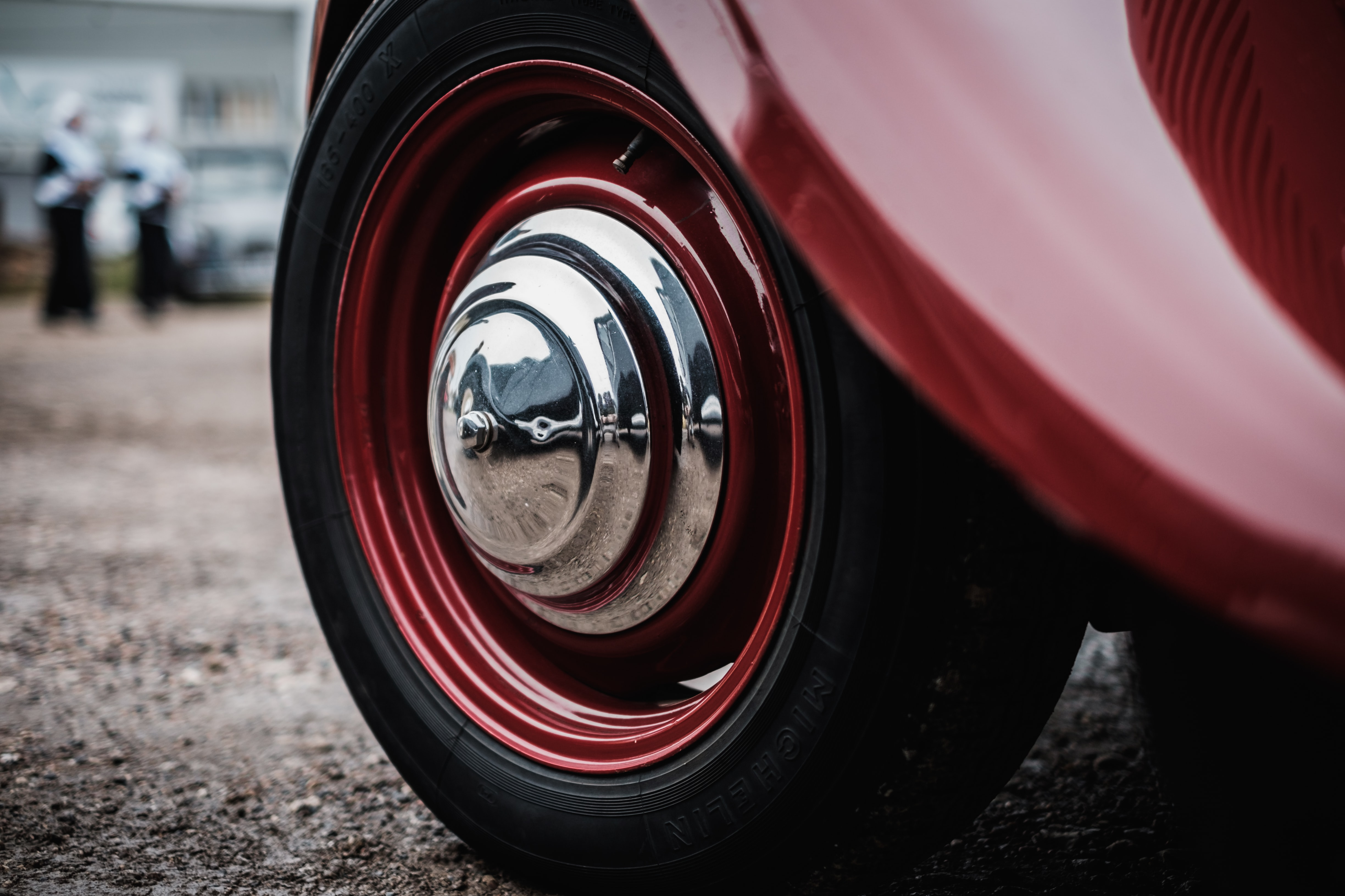 silver and red car wheel with tire
