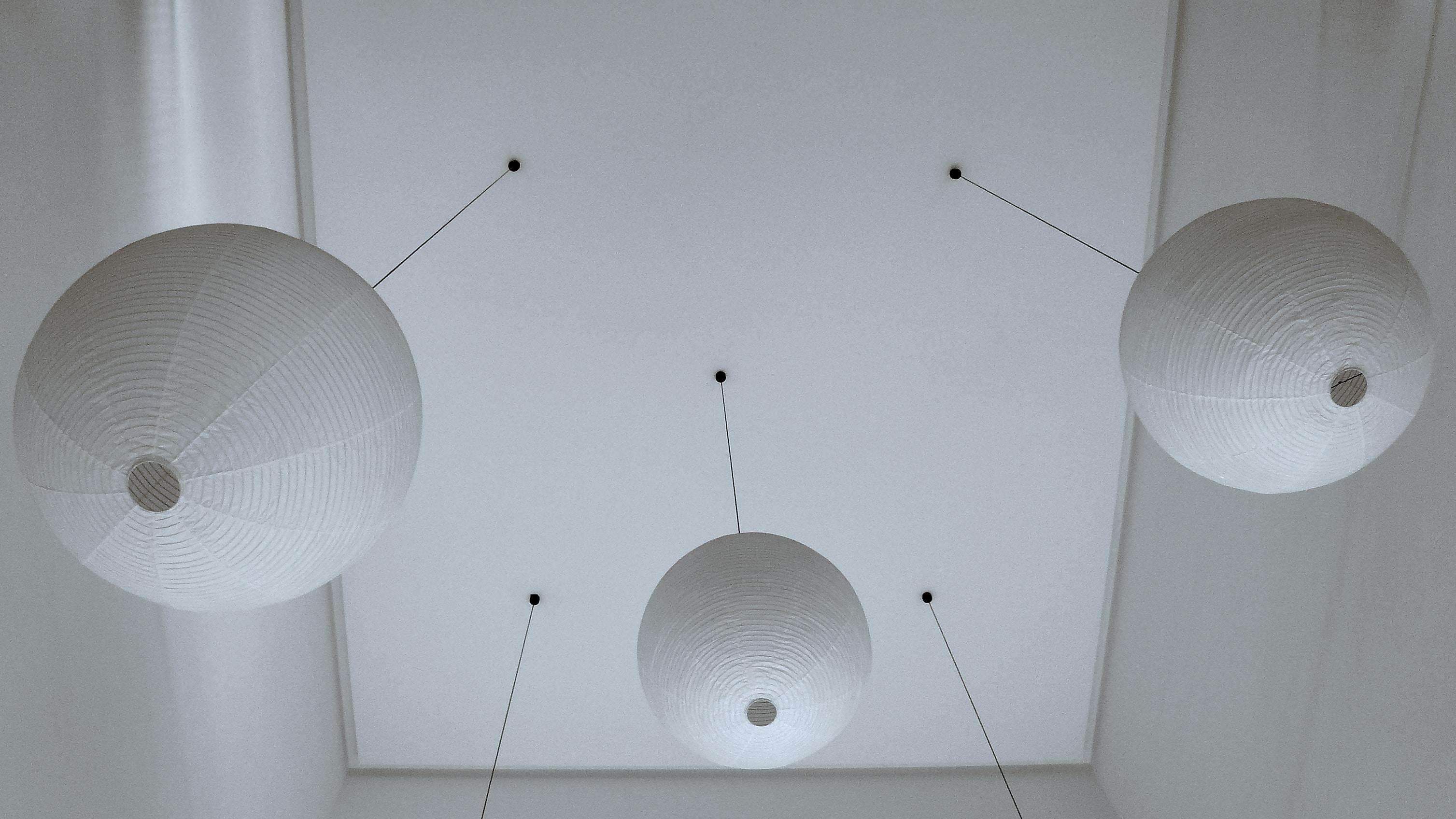 three white hanging pendants