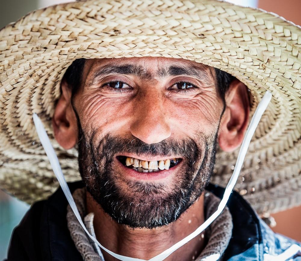 photo of man wearing brown sun hat