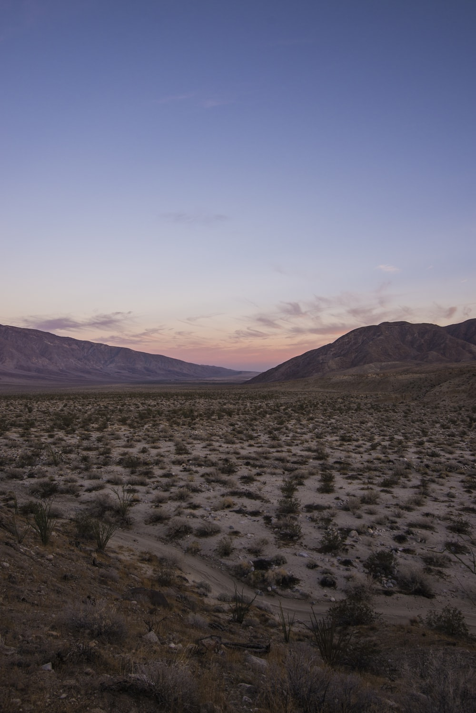 photo of barren land during golden hour