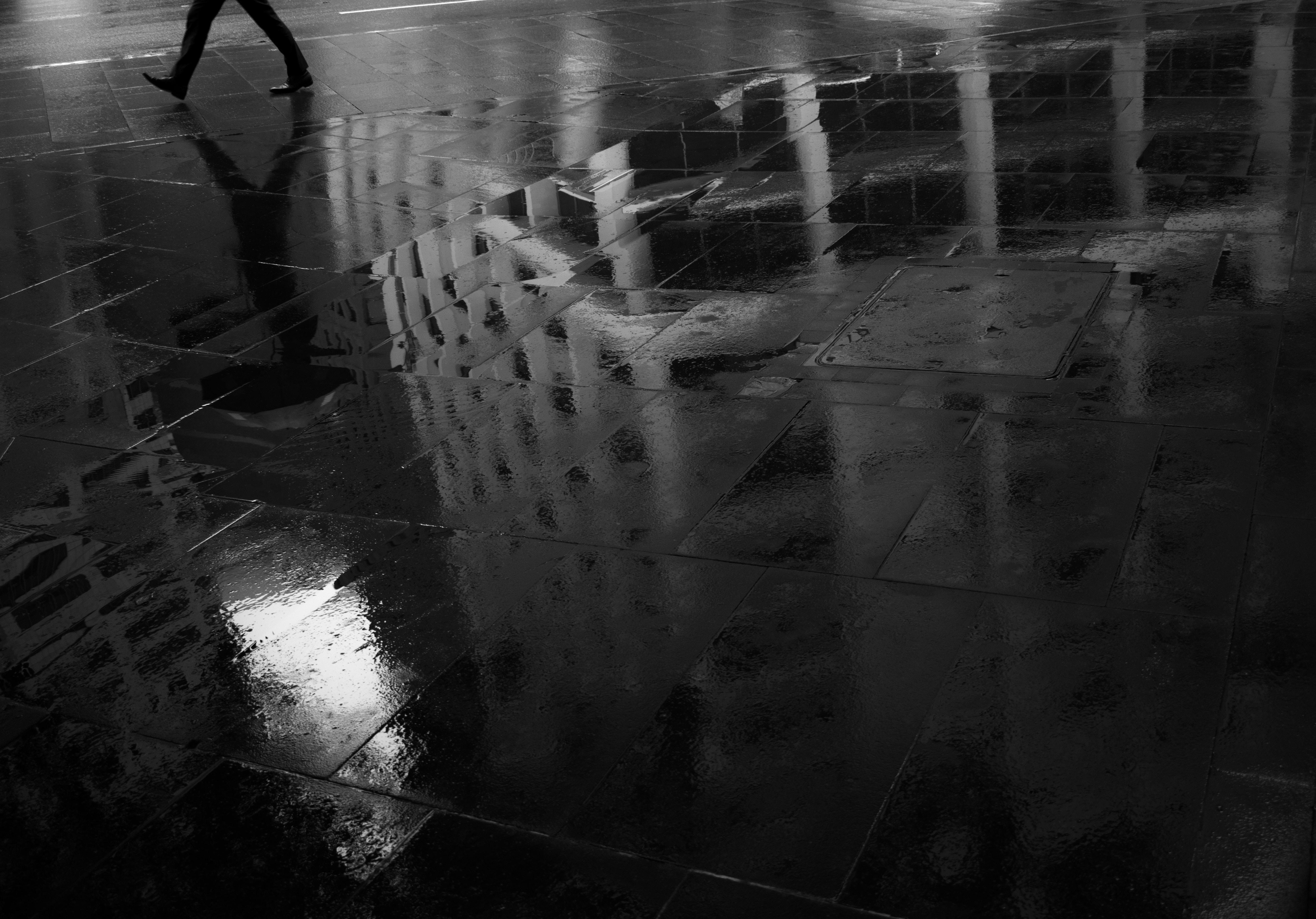 grayscale photo of black concrete floor
