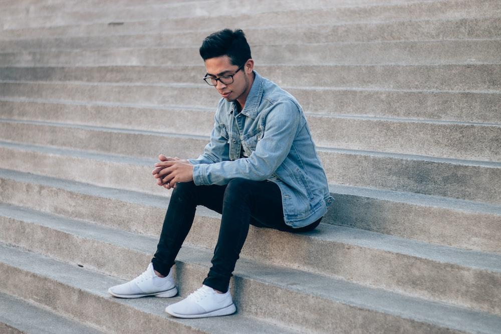 man sitting on concrete steps