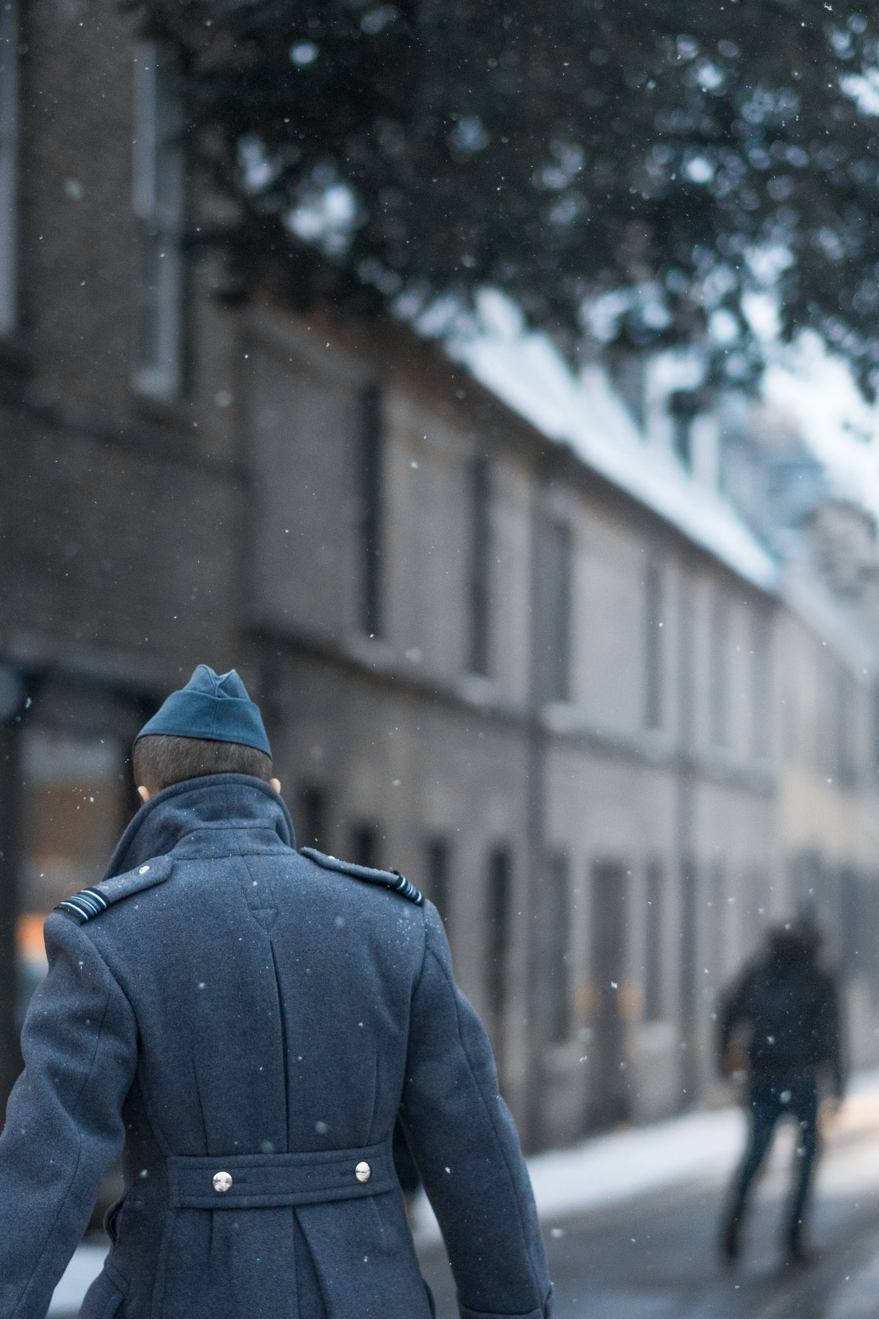 selective focus photo of man wearing gray coat during winter
