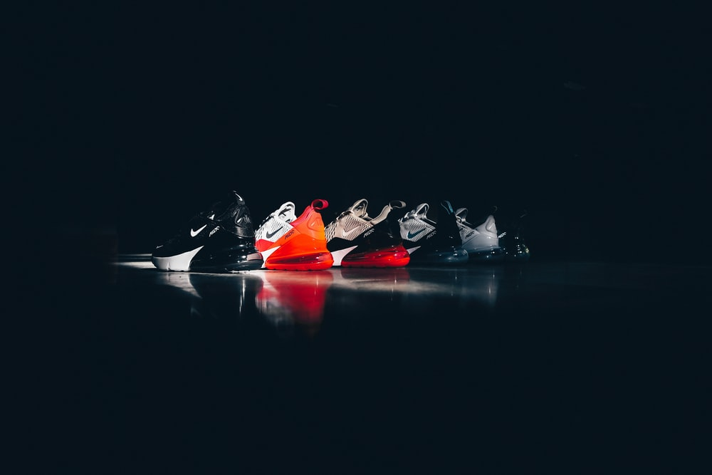 five assorted-color-and-unpaired Nike low-top sneakers