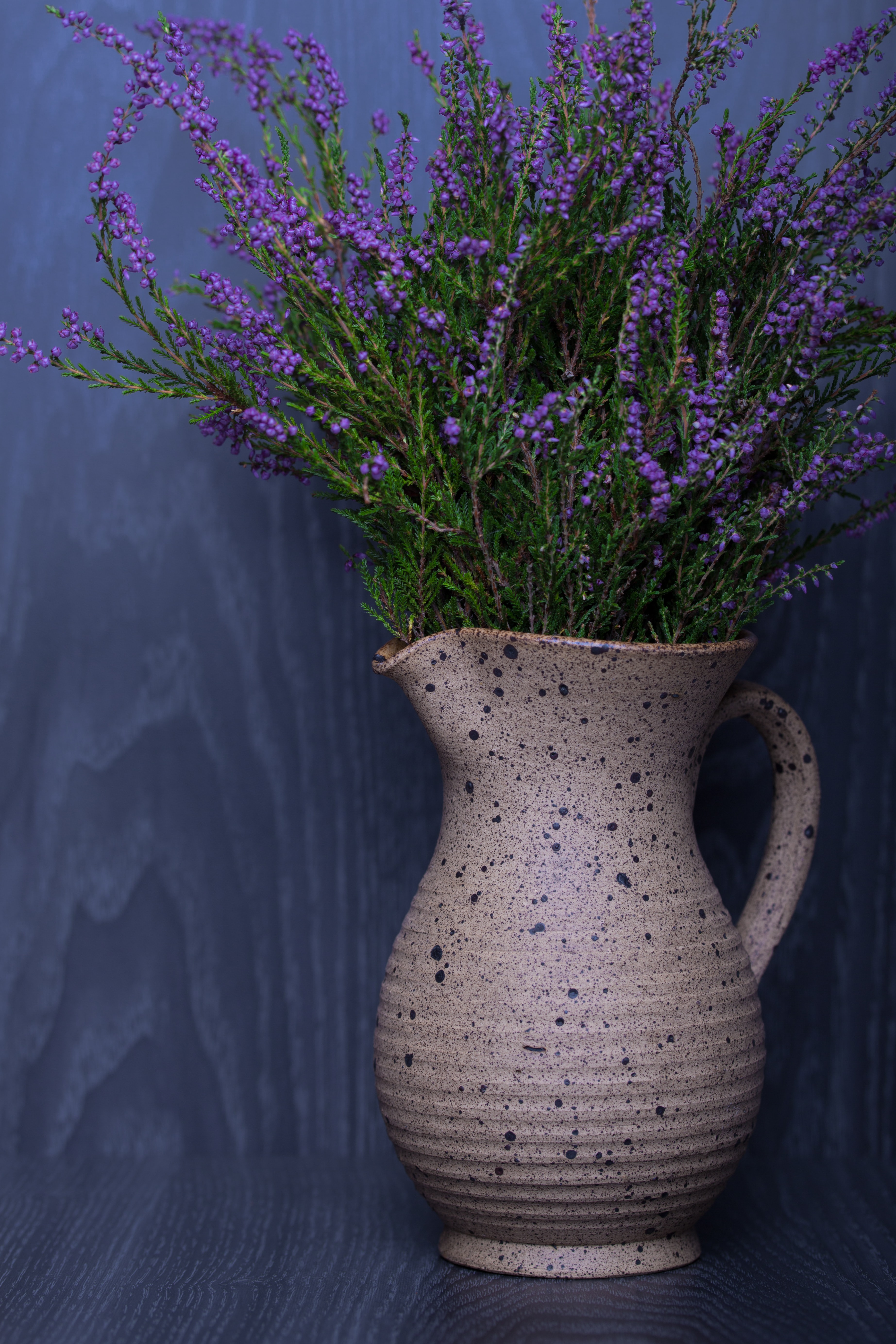 lavender flower in beige pitcher vase