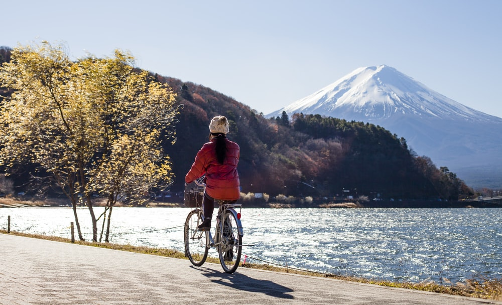 person riding bicycle near body of water